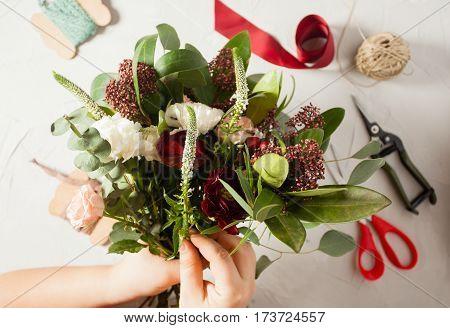 Close up bouquet preparation. Small business concept