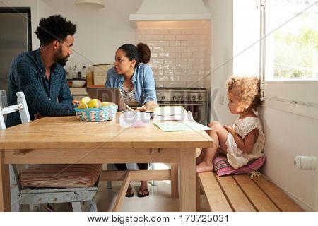 Unhappy Girl Watching Parents Arguing In Kitchen
