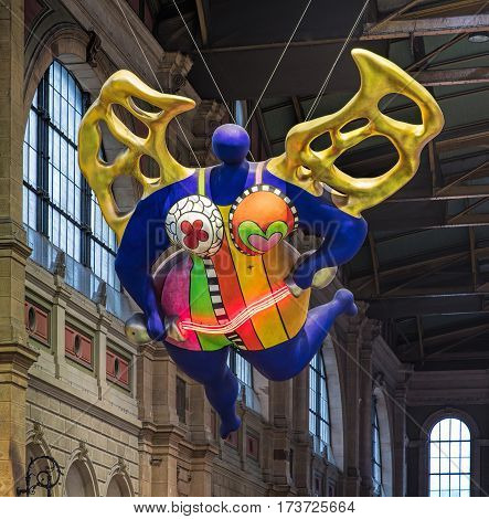 Zurich, Switzerland - 9 October, 2016: the famous Nana figure in the hall of the Zurich main railway station. The figure was created by a French sculptor, painter and filmmaker Niki de Saint Phalle (1930 - 2002).