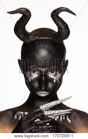 girl with horns on his head as hell