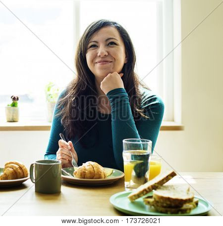 Caucasian Woman Eating Breakfast Pyjamas