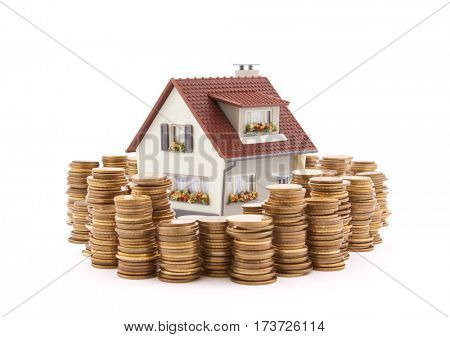 House with stack of coins