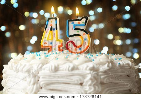 Birthday cake with candles on bokeh background