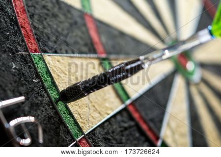 one metall dart hit the double sixteen