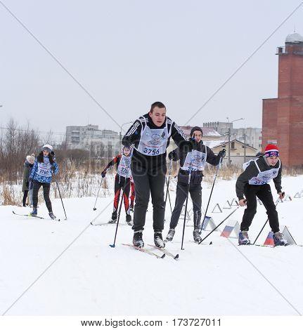 Kirishi, Russia - 11 February, Teenagers running on skis, 11 February, 2017. Mass ski race Russian Ski Track.