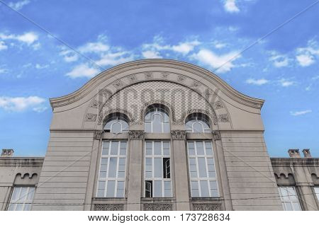 Old building detail with blue cloudy sky