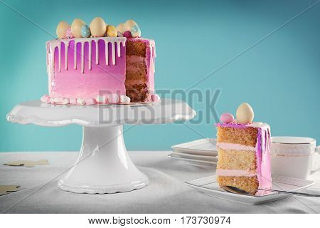 Sliced Easter cake on festive white stand