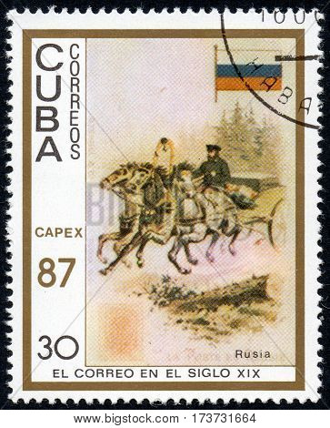 UKRAINE - CIRCA 2017: A stamp printed in Cuba shows a man carries the load on a cart with three horses Russia the series The mail in the nineteenth century circa 1987