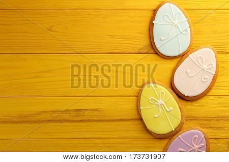 Creative Easter sugar cookies on yellow wooden background