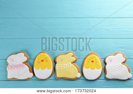 Creative Easter sugar cookies on turquoise wooden background