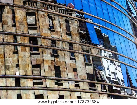 Building reflected in a mirror show window