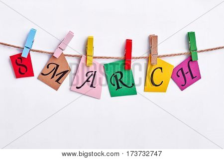 Coloured cards hanging on clothesline. Soulful congratulation for woman.