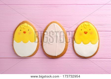 Creative Easter sugar cookies on pink wooden background