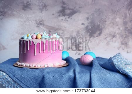 Beautiful Easter composition with cake and eggs