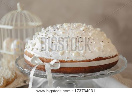Tasty Easter cake on light background