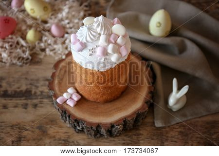 Tasty Easter cake with marshmallows on stump