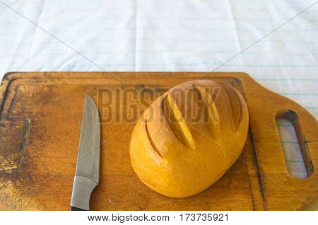 head of traditional Adygei cheese handmade with knife on wooden Board