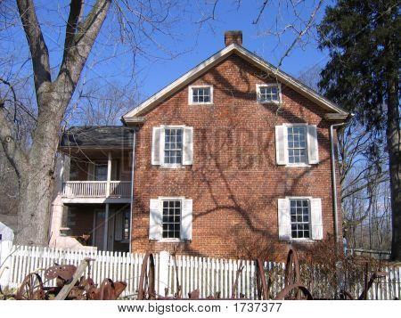 Brick Farmhouse With Shadows