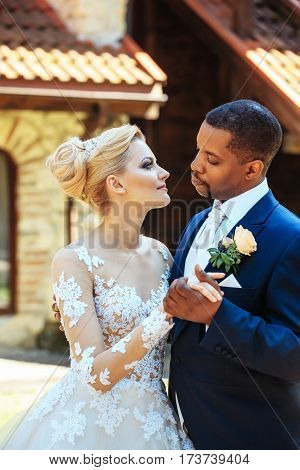 Handsome Groom Hugging Tenderly Pretty Bride
