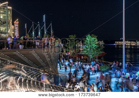 Chicago US - July 17 2016: Long exposure of crowds of people gathered at the Navy pier to watch a fireworks display
