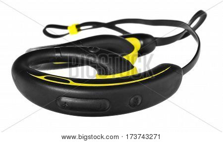 Waterproof headphones earphones yellow and black. Headphones for running in the rain and sports on heavy climatic conditions. Accessory for athletes isolated on white background with light shadow and reflection.