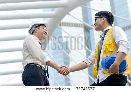 Architects Handshake And Business People Concept. Partnership,