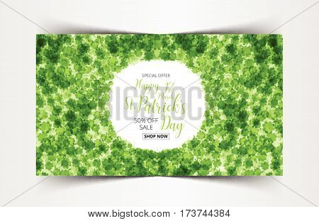 Vector Illustration of a St. Patrick's Day sale tag green clover leaves background