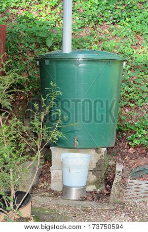 tank for receiving rainwater in a garden