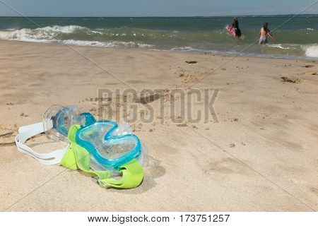 diving mask set on the sand as a symbol of holiday and sun