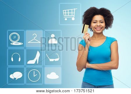 people, e-commerce and online shopping concept - happy afro american young woman with credit card over blue background with menu icons