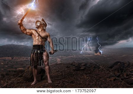 Rome Gladiator Posing On Drammatic Outdoor Nature. History Concept