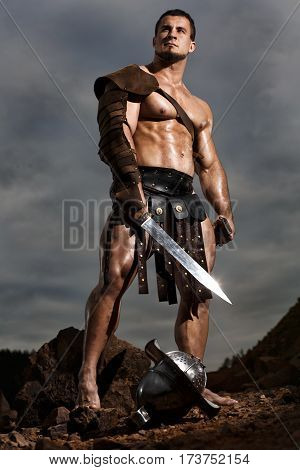 Rome Gladiator Posing On Drammatic Outdoor Nature