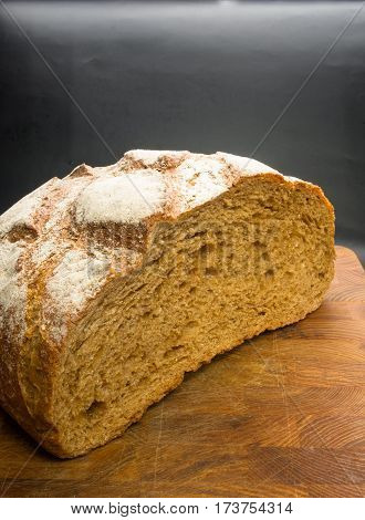 cut malt bread handmade on wooden background