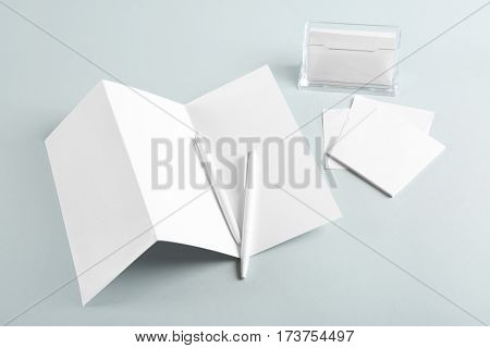 Blank office supplies on grey background