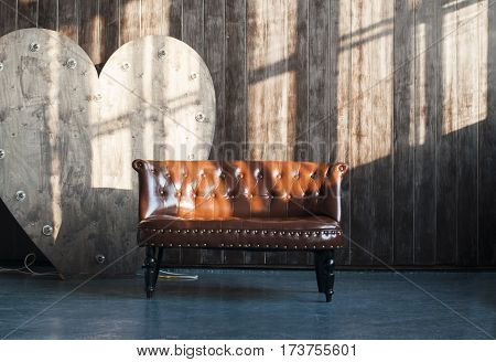 brown leather vintage sofa in loft apartment