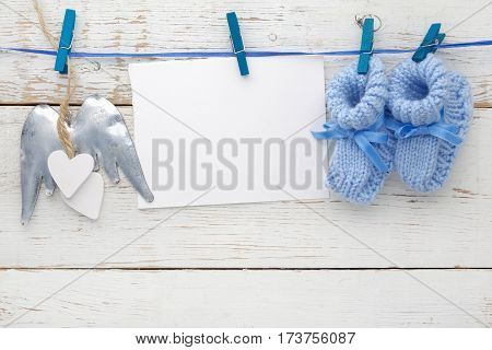 Greeting children form with blue booties and wings