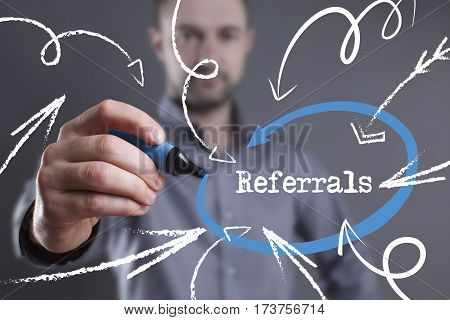 Technology, Internet, Business And Marketing. Young Business Man Writing Word: Referrals