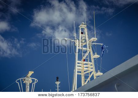 White Ship mast against the blue sky