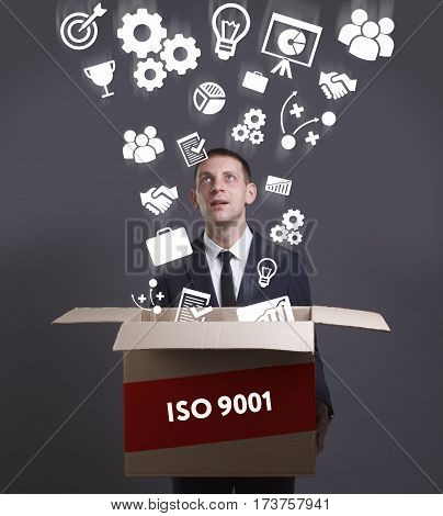 Business, Technology, Internet And Network Concept. Young Businessman Shows The Word: Iso 9001
