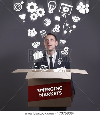 Business, Technology, Internet And Network Concept. Young Businessman Shows The Word: Emerging Marke