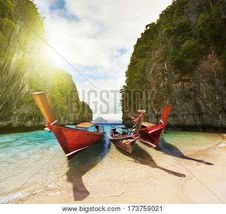 Boats on the beach inside small laguna