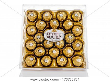 LONDON UK - FEBRUARY 28 Ferrero Rocher premium chocolate sweets plastic box.Produced by the Italian chocolatier Ferrero SpA.