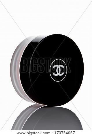 LONDON UK - FEBRUARY 28 2017 Chanel face cream container with black logo. On white background with reflection