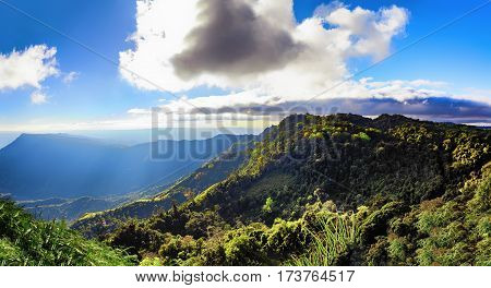 summer green jungle mountain with fog blue sky and clouds. landscape background.