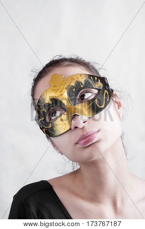 Girl Brunette In A Theatrical Mask Looking Up