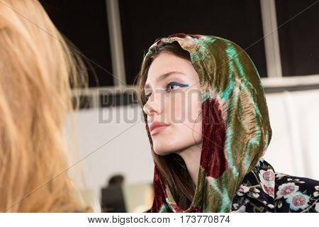 MILAN ITALY - FEBRUARY 22: Gorgeous model poses in the backstage just before Wunderkind show during Milan Women's Fashion Week on FEBRUARY 22 2017 in Milan.