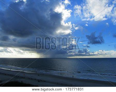 Rain and Cumulous Clouds over the Atlantic Ocean