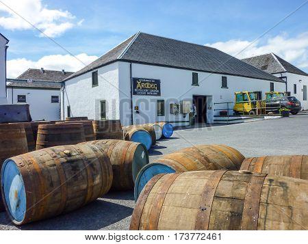 ISLAY, SCOTLAND - SEPTEMBER 11 2015: The sun shines on Ardbeg distillery warehouse