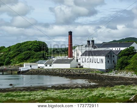 ISLAY, SCOTLAND - SEPTEMBER 11 2015: The sun shines on Lagavulin distillery warehouse