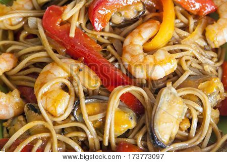 Buckwheat noodles soba with prawns and stir fry vegetables